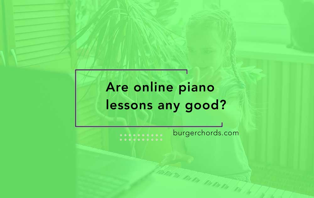 young girl waving at laptop during online piano lessons